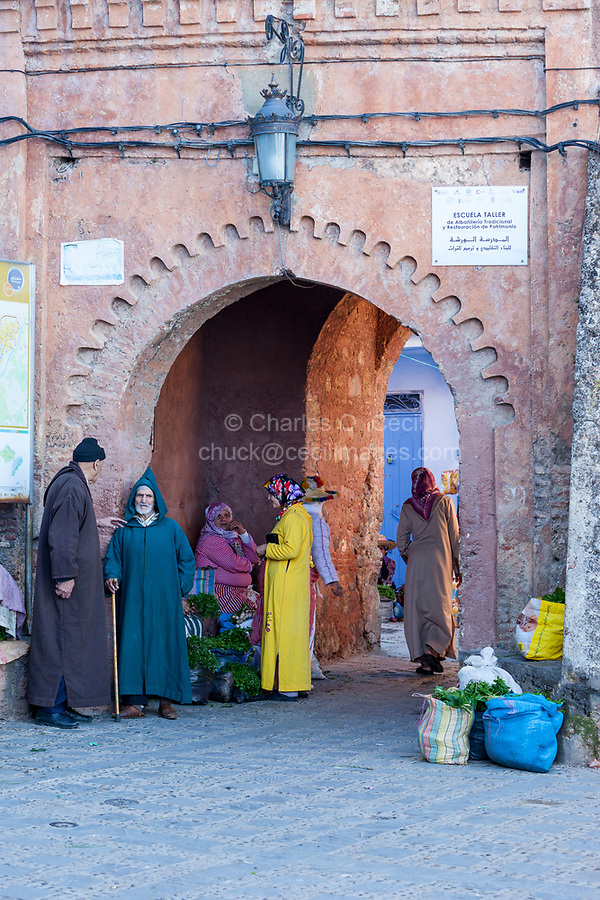 Chefchaouen, Morocco.  People Talking around the Entrance to the Medina.