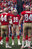 SAN FRANCISCO, CA:  Quarterback Joe Montana of the San Francisco 49ers in the huddle during a game at Candlestick Park in San Francisco, California in 1990. (Photo by Brad Mangin)