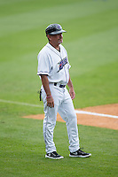 Winston-Salem Dash manager Tim Esmay (10) coaches third base during the Carolina League game against the Myrtle Beach Pelicans at BB&T Ballpark on April 18, 2015 in Winston-Salem, North Carolina.  The Pelicans defeated the Dash 4-1 in game one of a double-header.  (Brian Westerholt/Four Seam Images)