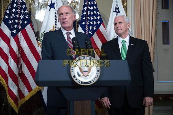 Director of National Intelligence Dan Coats (L), with United States Vice President Mike Pence (R), delivers remarks during a swearing in ceremony in the US Capitol in Washington, DC, USA, 16 March 2017.<br /> CAP/MPI/RS<br /> ©RS/MPI/Capital Pictures