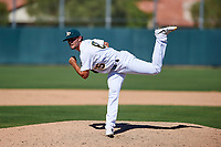 Oakland Athletics pitcher Logan Salow (65) follows through on his delivery during an Instructional League game against the Cincinnati Reds on September 29, 2017 at Lew Wolff Training Complex in Mesa, Arizona. (Zachary Lucy/Four Seam Images)