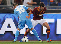 Calcio, Serie A: Roma vs Napoli. Roma, stadio Olimpico, 18 ottobre 2013.<br /> AS Roma midfielder Miralem Pjanic, of Bosnia, right, is challenged by Napoli midfielder Giandomenico Mesto during the Italian Serie A football match between AS Roma and Napoli at Rome's Olympic stadium, 18 October 2013.<br /> UPDATE IMAGES PRESS/Riccardo De Luca