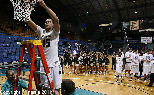SIOUX FALLS, SD - MARCH 8: Drew Valentine of Oakland University cuts down part of the net after defeating Oral Roberts during the 2011 Summit League Basketball Championship men's final Tuesday in Sioux Falls, S.D. ( (Photo by Dick Carlson/Inertia)..