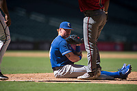 Kansas City Royals first baseman Chris DeVito (34) sits on the ground after being knocked over by a baserunner during an Instructional League game against the Arizona Diamondbacks at Chase Field on October 14, 2017 in Scottsdale, Arizona. (Zachary Lucy/Four Seam Images)