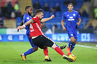 Luke Chambers of Ipswich is challenged by Junior Hoilett of Cardiff City during the Sky Bet Championship match between Cardiff City and Ipswich Town at The Cardiff City Stadium, Cardiff, Wales, UK. Tuesday 31 October 2017