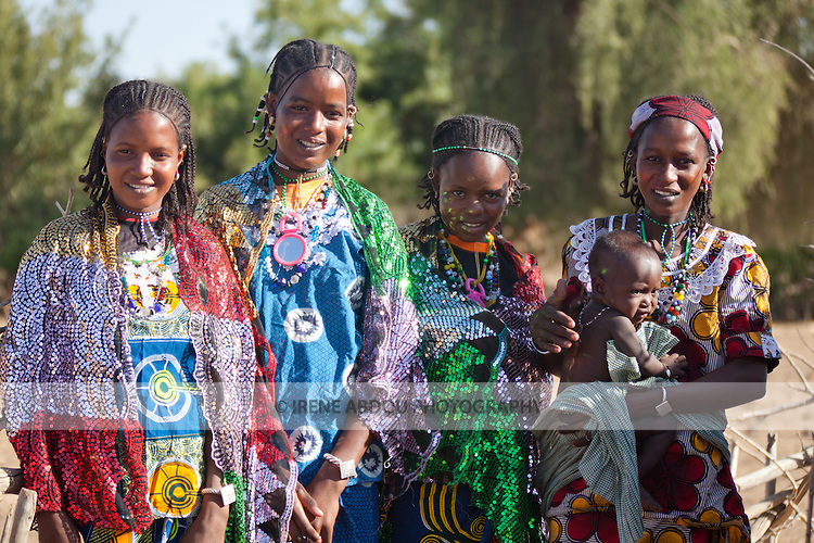 Fulani women in the seasonal village of Bantagiri in northern Burkina Faso.  The Fulani are traditionally nomadic pastoralists, crisscrossing the Sahel season after season in search of fresh water and green pastures for their cattle and other livestock.