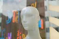 AVAILABLE FOR LICENSING FROM GETTY IMAGES. Please go to www.gettyimages.com and search for image # 129908294.<br /> <br /> Mannequin and Reflections of the City in the Window of a Women's Clothing Store, Fifth Avenue, Midtown Manhattan, New York City, New York State, USA