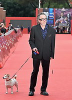 US director Tim Burton poses with his dog Levi on the red carpet as he arrives to receive a Lifetime Achievement Award, the 16th edition of the Rome Film Fest in Rome, on October 23, 2021.<br /> UPDATE IMAGES PRESS/Isabella Bonotto