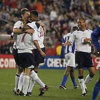 USA team celebrates, Honduras v USA, 2004.