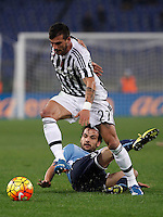 Calcio, Serie A: Lazio vs Juventus. Roma, stadio Olimpico, 4 dicembre 2015.<br /> Juventus' Stefano Sturaro is challenged by Lazio's Marco Parolo, bottom, during the Italian Serie A football match between Lazio and Juventus at Rome's Olympic stadium, 4 December 2015.<br /> UPDATE IMAGES PRESS/Isabella Bonotto