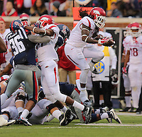 11/7/15<br /> Arkansas Democrat-Gazette/STEPHEN B. THORNTON<br /> Arkansas' Alex Collins plows over a pile of defenders during the second quarter of Saturday's game in Oxford, Miss.