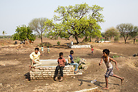 Young children play near dried up fields in the village of Sayyad Ankulga, near the city of Latur.