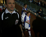 Blackburn Rovers 3, Huddersfield Town 1, 22/09/2005. Ewood Park, Carling Cup. The Rovers mascot getting a good luck pat on the head from Blackburn's Ryan Nelsen as the teams come out prior to kick-off. Photo by Colin McPherson.
