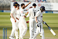 29th May 2021; Emirates Old Trafford, Manchester, Lancashire, England; County Championship Cricket, Lancashire versus Yorkshire, Day 3; Saqib Mahmood celebrates with team mates after giving Lancashire a second wicket before the close, dismissing Tom Kohler-Cadmore of Yorkshire lbw for 32