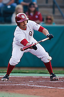 Tyler Ogle (35) bunts during the NCAA matchup between the University of Arkansas-Little Rock Trojans and the University of Oklahoma Sooners at L. Dale Mitchell Park in Norman, Oklahoma; March 11th, 2011.  Oklahoma won 11-3.  Photo by William Purnell/Four Seam Images
