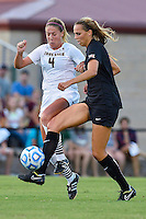 Texas midfielder Lindsey Meyer (4) and Texas State forward Lynsey Curry (4) fight for ball possession during the first half of NCAA soccer game, Sunday, September 21, 2014 in San Marcos, Tex. Texas defeated Texas State 2-0. (Mo Khursheed/TFV Media via AP Images)