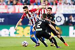 Yannick Ferreira Carrasco of Atletico de Madrid fights for the ball with Tito and Isaac Cuenca of Granada CF during their La Liga match between Atletico de Madrid and Granada CF at the Vicente Calderon Stadium on 15 October 2016 in Madrid, Spain. Photo by Diego Gonzalez Souto / Power Sport Images
