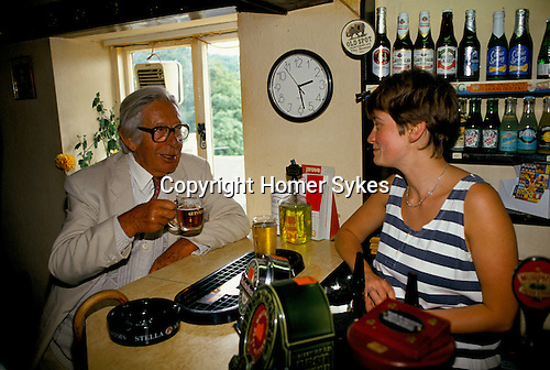 Laurie Lee author in his local pub The Woolpack ordering a lunchtime drink Slad Gloucestershire 1994 1990s