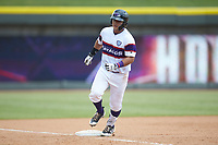 Daniel Gonzalez (17) of the Winston-Salem Rayados rounds third base after hitting a home run against the Potomac Nationals at BB&T Ballpark on August 12, 2018 in Winston-Salem, North Carolina. The Rayados defeated the Nationals 6-3. (Brian Westerholt/Four Seam Images)