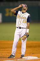Montgomery Biscuits first baseman Gabby Martinez downs some David's Sunflower Seeds before the start of an inning versus the Chattanooga Lookouts at Riverwalk Stadium in Montgomery, AL, Friday, August 18, 2006.