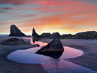 Low tide pools and seastacks reflecting sunrise. Bandon Beach. Oregon