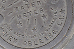 A New Orleans water meter cover in the French Quarter.