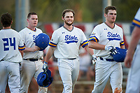 South Dakota State Jackrabbits Ryan McDonald (8), Landon Badger (11), and Colton Cox (12) celebrate a home run during a game against the Northeastern Huskies on February 23, 2019 at North Charlotte Regional Park in Port Charlotte, Florida.  Northeastern defeated South Dakota State 12-9.  (Mike Janes/Four Seam Images)