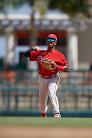 Philadelphia Phillies Luis Garcia (5) throws to first base during a Florida Instructional League game against the Baltimore Orioles on October 4, 2018 at Ed Smith Stadium in Sarasota, Florida.  (Mike Janes/Four Seam Images)