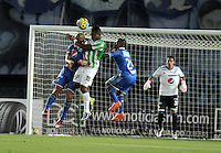 BOGOTA- COLOMBIA -09 -02-2014: Andres Cadavid (izq.) Alex Diaz (Der.) jugadores de Millonarios disputa el balón con Wilder Guisao (Cent.) jugador de Atletico Nacional durante partido de la cuarta fecha de la Liga Postobon I 2014, jugado en el Nemesio Camacho El Campin de la ciudad de Bogota. / Andres Cadavid (L) and Alex Diaz (R) players of Millonarios Fe vies for the ball with Wilder Guisao (C) player of Atletico Nacional during a match for the fourth date of the Liga Postobon I 2014 at the Nemesio Camacho El Campin Stadium in Bogoto city. Photo: VizzorImage  / Luis Ramirez / Staff