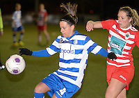 20140221 - OOSTAKKER , BELGIUM : Gent Kay Cuvelier (l) pictured with Antwerp Sophie Mannaert in her back (r) during the soccer match between the women teams of AA Gent Ladies  and RAFC Antwerp Ladies , on the 19th matchday of the BeNeleague competition Friday 21 February 2014 in Oostakker. PHOTO DAVID CATRY