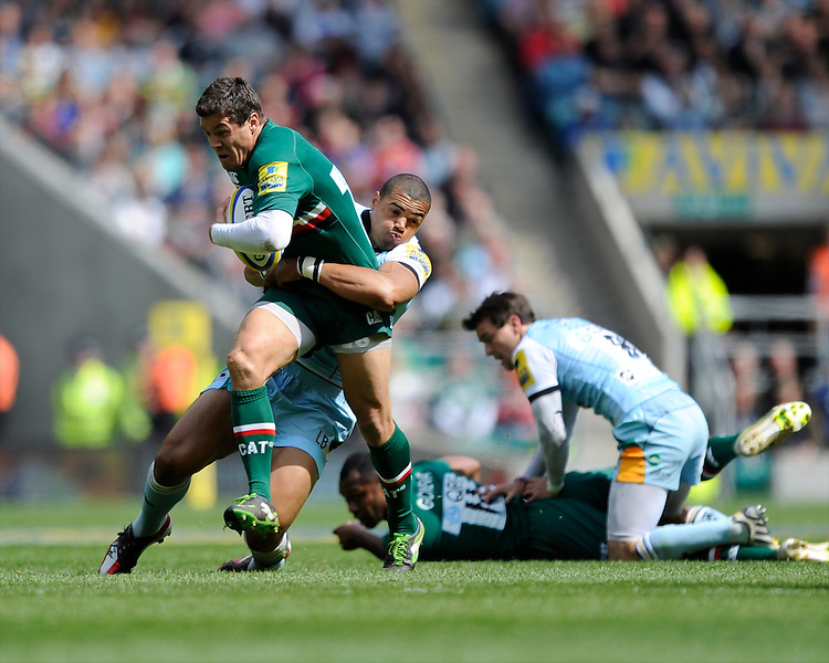 Anthony Allen of Leicester Tigers is tackled by Luther Burrell of Northampton Saints during the Aviva Premiership Final between Leicester Tigers and Northampton Saints at Twickenham Stadium on Saturday 25th May 2013 (Photo by Rob Munro)