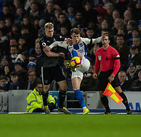 Brighton & Hove Albion's Solly March (right) is tackled by Burnley's Ben Mee (left)<br /> <br /> Photographer David Horton/CameraSport<br /> <br /> The Premier League - Brighton and Hove Albion v Burnley - Saturday 9th February 2019 - The Amex Stadium - Brighton<br /> <br /> World Copyright © 2019 CameraSport. All rights reserved. 43 Linden Ave. Countesthorpe. Leicester. England. LE8 5PG - Tel: +44 (0) 116 277 4147 - admin@camerasport.com - www.camerasport.com