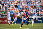 Unai Bustinza of Deportivo Leganes battles for the ball with Paco Alcacer of FC Barcelona during their La Liga match between Deportivo Leganes and FC Barcelona at the Butarque Municipal Stadium on 17 September 2016 in Madrid, Spain. Photo by Diego Gonzalez Souto / Power Sport Images