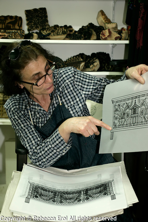Traditional textile printer Veliye Marti shows her template designs in Istanbul, Turkey, by