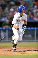Asheville Tourists third baseman Ryan McMahon #5 at bat during a game against the Savannah Sand Gnats at McCormick Field September 3, 2014 in Asheville, North Carolina. The Tourists defeated the Sand Gnats 8-3. (Tony Farlow/Four Seam Images)