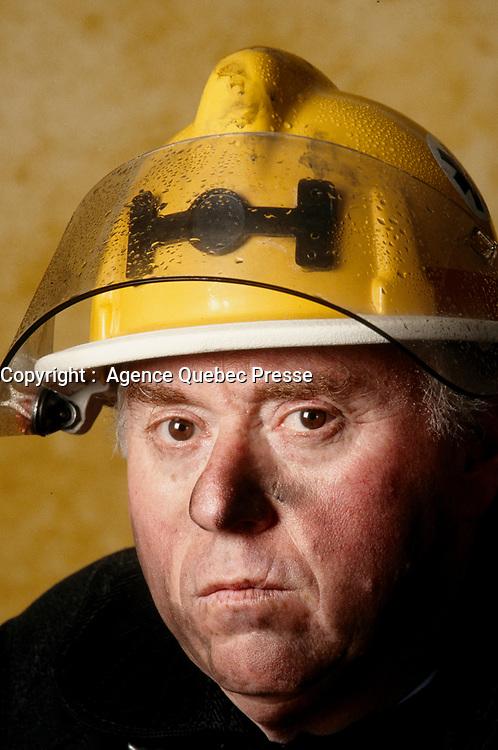 1999 File Photo - Montreal (qc) CANADA - Model release photo, man in a fireman suit and hat<br /> <br /> ILLUSTRATION : le metier de Pompier