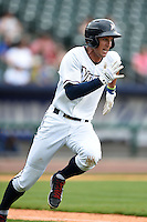 NW Arkansas Naturals outfielder Lane Adams (6) runs to first during a game against the Corpus Christi Hooks on May 26, 2014 at Arvest Ballpark in Springdale, Arkansas.  NW Arkansas defeated Corpus Christi 5-3.  (Mike Janes/Four Seam Images)