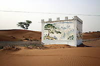 A small building in the desert in the western reaches of Inner Mongolia. The area is plagued by increasing desertification that is ravaging the region.
