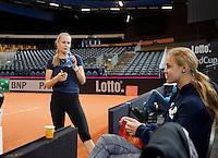 Februari 04, 2015, Apeldoorn, Omnisport, Fed Cup, Netherlands-Slovakia, Magdaléna Rybáriková (SLO) and Anna Karolína Schmiedlová (R)<br /> Photo: Tennisimages/Henk Koster