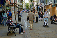 Pedestrians and shoppers on the main street of Gibraltar.