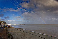 A rainbow fades above Penarth Pier in south Wales, UK. Tuesday 27 October 2020
