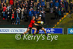 Gavin White Dr Crokes drives past Stephen O'Brien Kenmare   during their Club Championship game in Lewis Road on Sunday