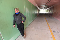 Craig Colorusso talks about his sound mural inside the tunnel where bike riders and pedestrians can hear his original composition. The tunnel is at Maple Grove Park two blocks south of downtown Rogers.<br />(NWA Democrat-Gazette/Flip Putthoff)