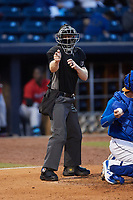 Home plate umpire Travis Godec makes a strike call during the game between the Jacksonville Jumbo Shrimp and the Durham Bulls at Durham Bulls Athletic Park on May 15, 2021 in Durham, North Carolina. (Brian Westerholt/Four Seam Images)