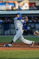 Juandy Mendoza (10) of the Bluefield Blue Jays follows through on his swing against the Burlington Royals at Burlington Athletic Stadium on June 28, 2016 in Burlington, North Carolina.  The Royals defeated the Blue Jays 4-0.  (Brian Westerholt/Four Seam Images)