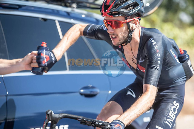 Adam Yates (GBR) back at the team car for refreshments during Stage 2 of La Vuelta d'Espana 2021, running 166.7km from Caleruega. VIII Centenario de Santo Domingo de Guzmán to Burgos. Gamonal, Spain. 15th August 2021.    <br /> Picture: Unipublic/Charly Lopez | Cyclefile<br /> <br /> All photos usage must carry mandatory copyright credit (© Cyclefile | Unipublic/Charly Lopez)