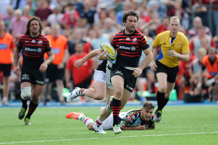 Marcelo Bosch of Saracens breaks through the tackle of Danny Care of Harlequins during the Aviva Premiership semi final match between Saracens and Harlequins at Allianz Park on Saturday 17th May 2014 (Photo by Rob Munro)