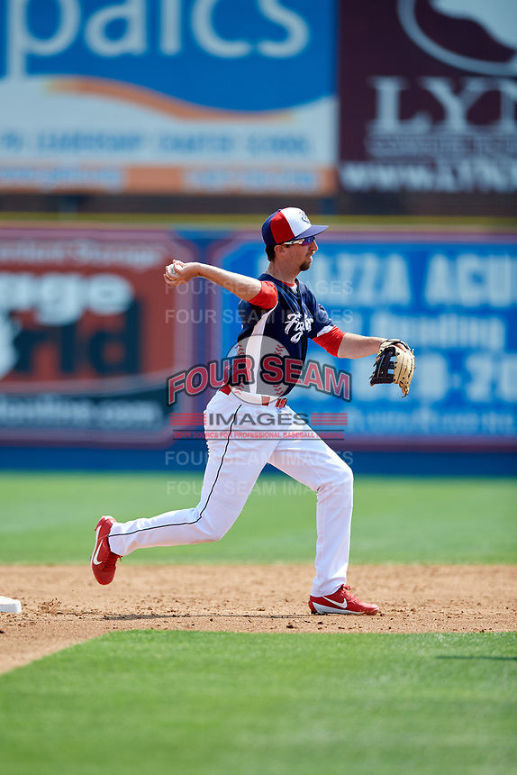 Reading Fightin Phils second baseman Brandon Bednar (19) turns a double play during the first game of a doubleheader against the Portland Sea Dogs on May 15, 2018 at FirstEnergy Stadium in Reading, Pennsylvania.  Portland defeated Reading 8-4.  (Mike Janes/Four Seam Images)