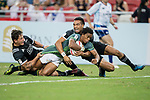 New Zealand's players tackle Tim Agaba of South Africa who has the ball during the match South Africa vs New Zealand, Day 2 of the HSBC Singapore Rugby Sevens as part of the World Rugby HSBC World Rugby Sevens Series 2016-17 at the National Stadium on 16 April 2017 in Singapore. Photo by Victor Fraile / Power Sport Images