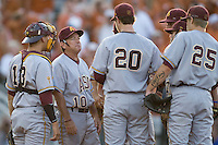 Arizona State Sun Devil Coach Tim Esmay #10 talks with starting pitcher Brady Rodgers #20 during their game against the Texas Longhorns in NCAA Tournament Super Regional baseball on June 10, 2011 at Disch Falk Field in Austin, Texas. (Photo by Andrew Woolley / Four Seam Images)